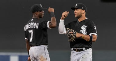 White Sox shortstop Tim Anderson (7) and infielder Yoan Moncada (10) celebrate in 2018.