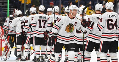Blackhawks center Jonathan Toews (19) celebrates with teammates after a win against the Predators.