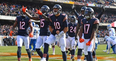 Bears quarterback Mitchell Trubisky (10) and teammates celebrate a touchdown.