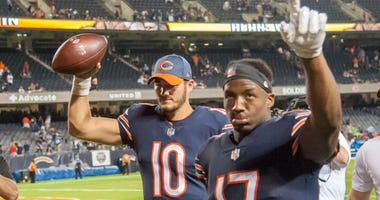 Bears quarterback Mitchell Trubisky, left, and receiver Anthony Miller celebrate a win.