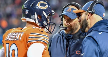 Bears coach Matt Nagy, center, talks with quarterback Mitchell Trubisky (10).