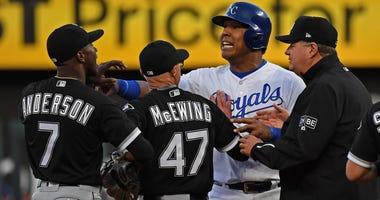 White Sox shortstop Tim Anderson, far left, and Royals catcher Salvador Perez exchange words.