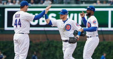 Cubs first baseman Anthony Rizzo (left), outfielder Ian Happ (center) and outfielder Jason Heyward celebrate.