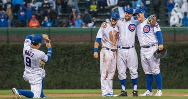 The Cubs celebrate after a win against the Cardinals.