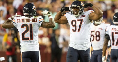 Bears defensive lineman Nick Williams (97) celebrates.