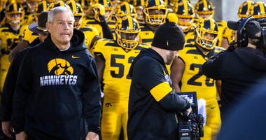 Iowa coach Kirk Ferentz, left