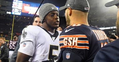 Teddy Bridgewater, left, and Mitchell Trubisky exchange pleasantries after the Saints defeated the Bears.