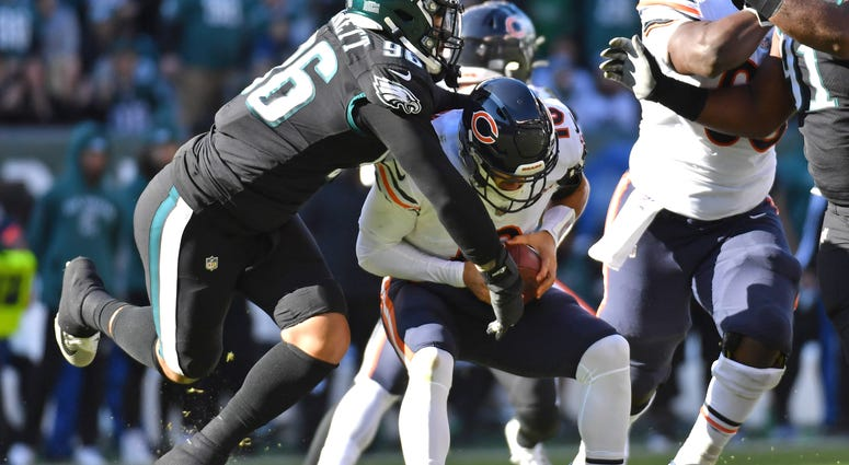 Bears quarterback Mitchell Trubisky (10) is tackled by the Eagles.