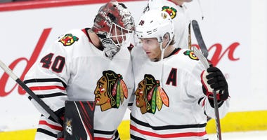 Blackhawks goalie Robin Lehner, left, and winger Patrick Kane celebrate.