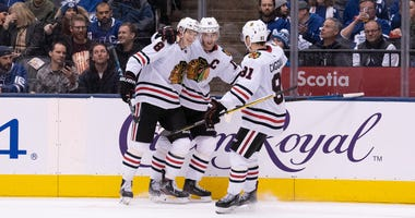 Blackhawks left wing Dominik Kubalik (8) celebrates with center Jonathan Toews (19) after a goal against the Toronto Maple Leafs.