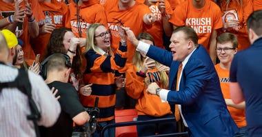 Illinois coach Brad Underwood celebrates with fans.