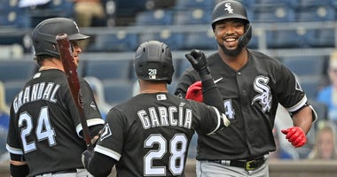 White Sox outfielder Eloy Jimenez, right, is congratulated by teammates.