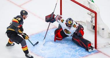 Blackhawks goalie Corey Crawford, right