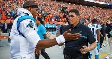 Quarterback Cam Newton and coach Ron Rivera while they were with the Panthers