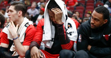 Bulls forward Wendell Carter Jr., center, reacts on the bench.