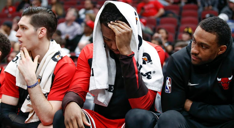 Bulls forward Wendell Carter Jr., center, reacts on the bench.