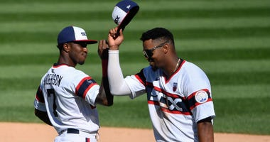 White Sox shortstop Tim Anderson, left, and outfielder Eloy Jimenez celebrate a win against the Cardinals.