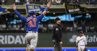 Cubs catcher Willson Contreras (40) reacts after left fielder Kyle Schwarber (not pictured) hit a grand slam against the Brewers.