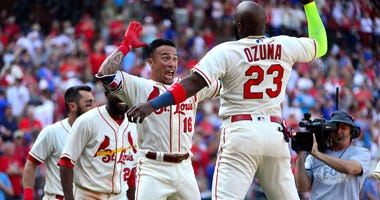 Kolten Wong (center) celebrates the Cardinals' walk-off win over the Cubs with teammate Marcell Ozuna.