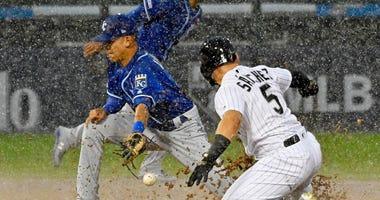 White Sox second baseman Yolmer Sanchez (5) steals second base as Royals second baseman Nicky Lopez (1) takes the throw.