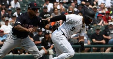 White Sox second baseman Yolmer Sanchez (5) is tagged out on a steal attempt by Indians third baseman Jose Ramirez.