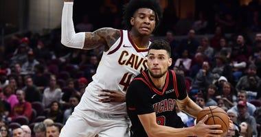 Bulls guard Zach LaVine (8) drives to the basket against Cavaliers guard Kevin Porter Jr. (4).