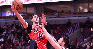 Bulls guard Zach LaVine shoots over Cavaliers guard Matthew Dellavedova.