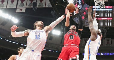 Bulls guard Zach LaVine goes up for a shot against the Thunder.