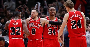 Bulls guard Zach LaVine (8) celebrates with teammates after scoring a late basket against the Clippers.