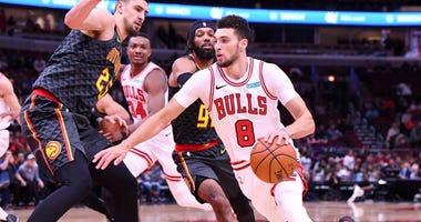 Bulls guard Zach LaVine (8) drives on Hawks center Alex Len (25).