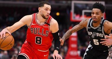 Bulls guard Zach LaVine (8) dribbles the ball against Spurs guard Dejounte Murray (5).
