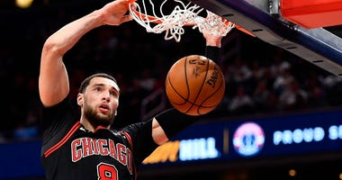 Bulls guard Zach LaVine (8) dunks the ball against the Wizards.