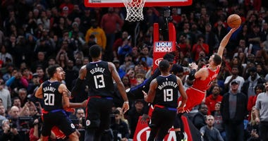 Bulls guard Zach LaVine (8) scores the winning basket against the Clippers in the waning seconds.