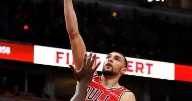 Bulls guard Zach LaVine (8) shoots a layup against Hawks center Damian Jones (30).