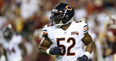 Khalil Mack jogs onto the field for the Bears