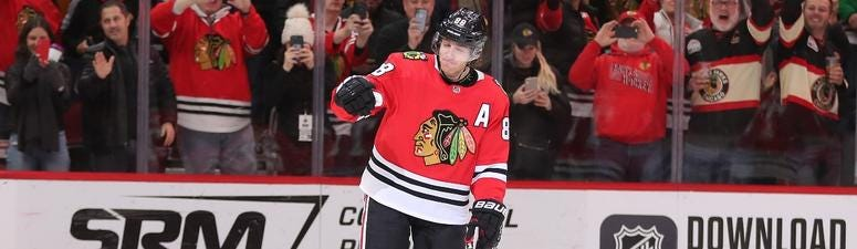 Blackhawks right wing Patrick Kane (88) celebrates scoring his 1,000th point on an assist against the Winnipeg Jets.