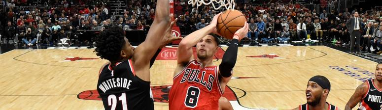Bulls guard Zach LaVine (8) goes to the basket as Trail Blazers center Hassan Whiteside (21) defends.