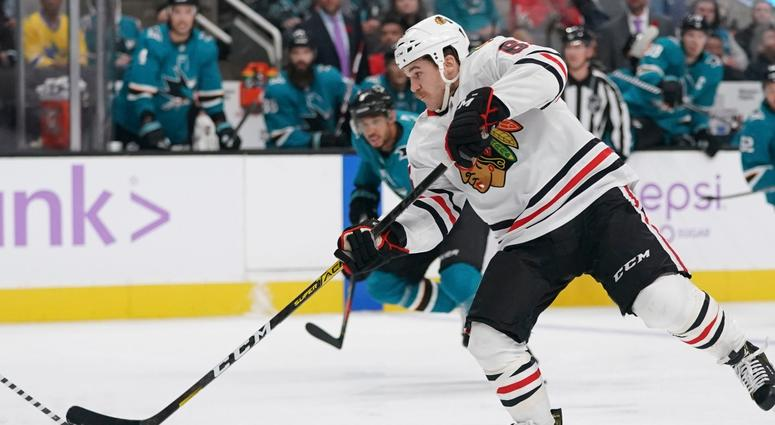 Blackhawks center Andrew Shaw (65) shoots the puck against the Sharks.