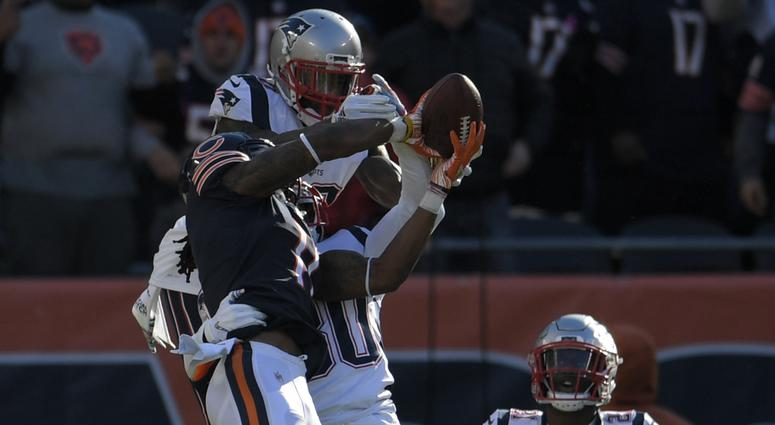 Bears receiver Kevin White catches a Hail Mary but is tackled just short of the end zone against the Patriots.