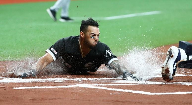 White Sox outfielder Leury Garcia (28) slides safe into home plate.