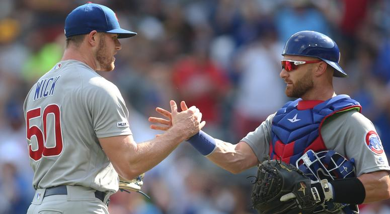 Cubs reliever Rowan Wick (50) and catcher Jonathan Lucroy (25) celebrate the Cubs' win against the Pirates.