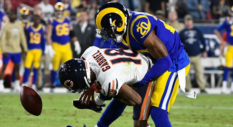 Rams cornerback Jalen Ramsey (20) breaks up a pass to Bears receiver Taylor Gabriel (18).