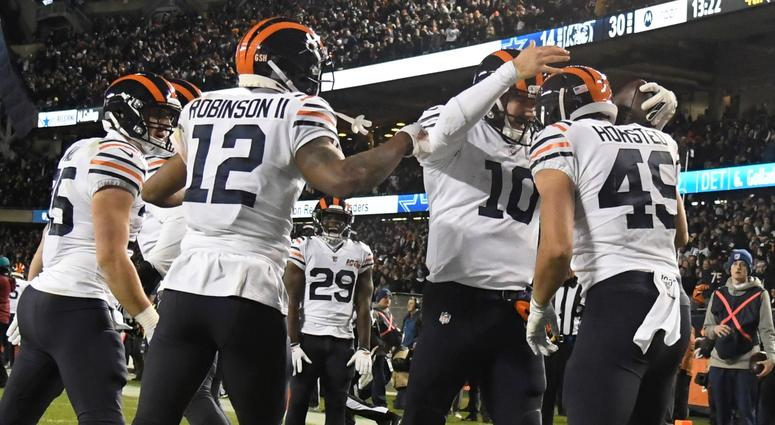 Bears quarterback Mitchell Trubisky (10) celebrates with teammates after scoring on a touchdown run against the Cowboys.