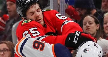 Blackhawks center Andrew Shaw (65) checks Edmonton Oilers defenseman Joel Persson (36).