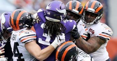 Members of the Bears defense tackle Vikings running back Dalvin Cook.