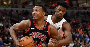 Bulls big man Wendell Carter Jr. is defended by Heat forward Jimmy Butler.