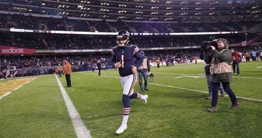 Bears kicker Cody Parkey leaves the field after missing a game-winning field-goal attempt.