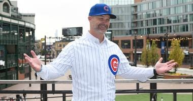 Cubs manager David Ross poses at his introductory press conference.