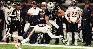 Raiders tight end Foster Moreau is tackled by Bears safety Eddie Jackson.