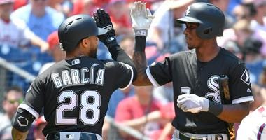 White Sox center fielder Leury Garcia (28) celebrates with shortstop Tim Anderson (7) after hitting a grand slam.